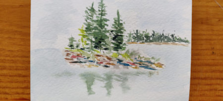A small watercolor of trees on an island reflecting in water