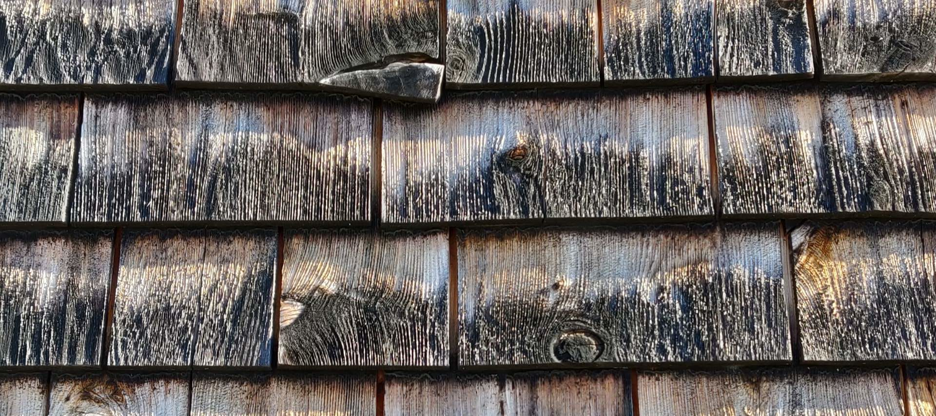 Close up view of weathered cedar shingles